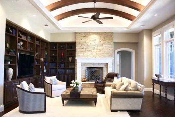 Traditional San Antonio Custom Home - Living Room with Brown Arch Beams