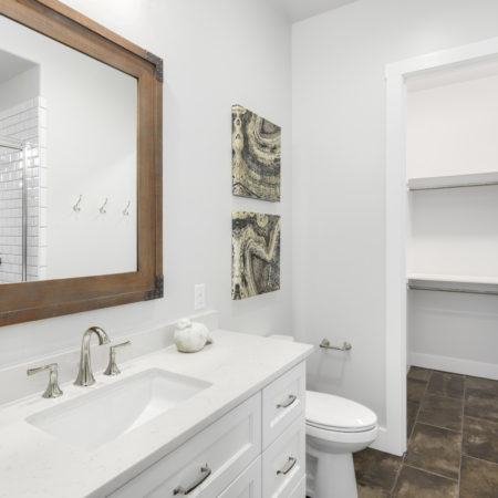 Bathroom connected to closet in San Antonio Modern Farmhouse