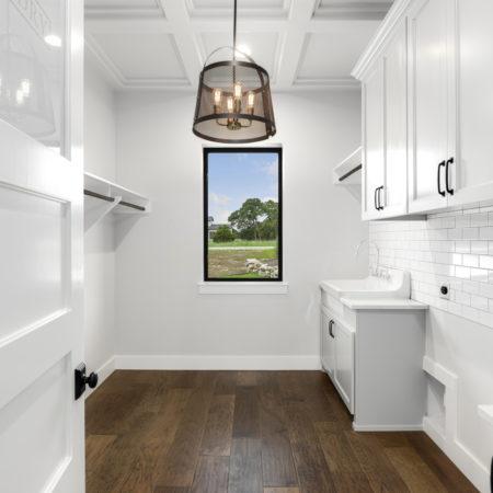 White Tile Backsplash in Utility Room of the Modern San Antonio Farmhouse