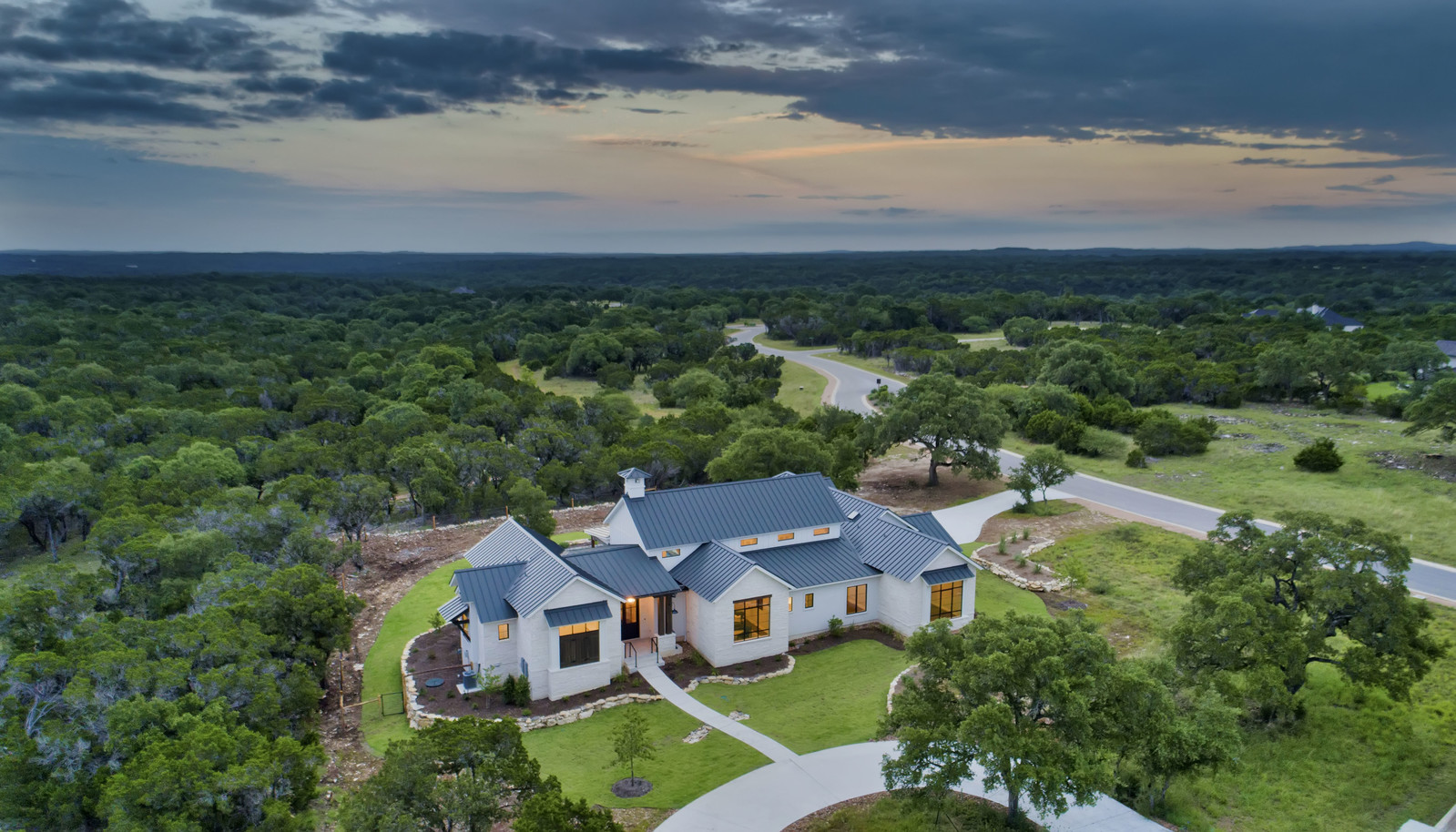 Aerial Sunset View of our Modern Farmhouse in the Springs of Cordillera Ranch
