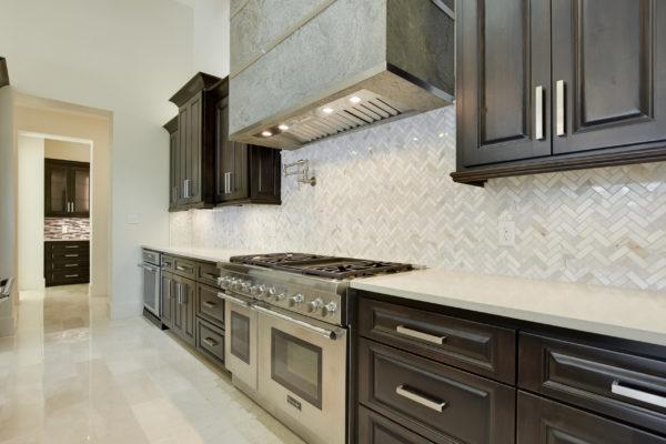 Light Gray Zig Zag Tile Backsplash in Kitchen of Cordillera Ranch House