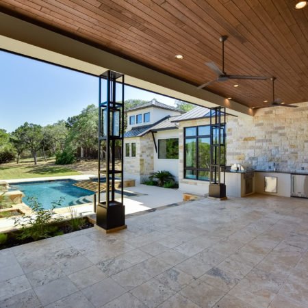 Outdoor Kitchen View of Mixed Limestone House in Cordillera Ranch