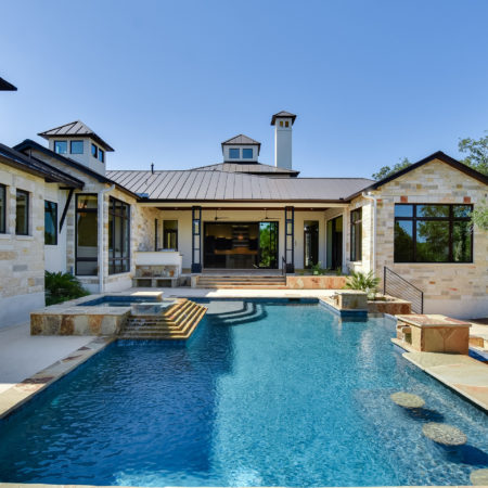 Back View with Pool of Mixed Limestone House in Cordillera Ranch