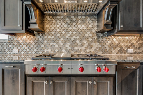 San Antonio Custom Home Builder - Traditional Style Home Kitchen with High End Cook Top
